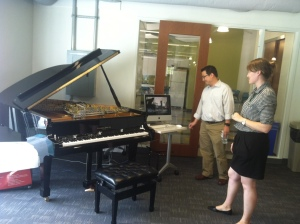 "The Center's Director Youngmoo Kim and ""Enabler"" Kara Lindstrom demonstrate the Magnetic Resonator Piano"